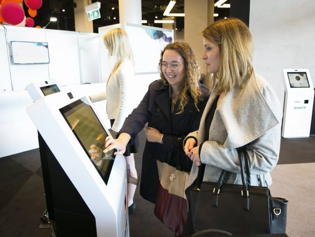 attendees checking in at kiosks at an event