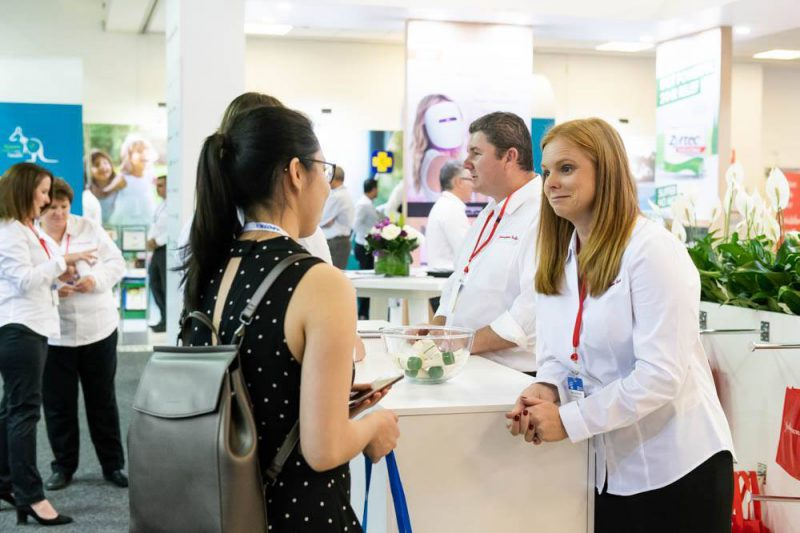 attendee visiting exhibitor at APP exhibition