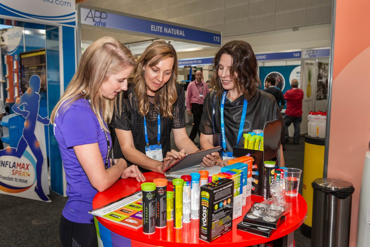 delegates interacting with exhibitors products