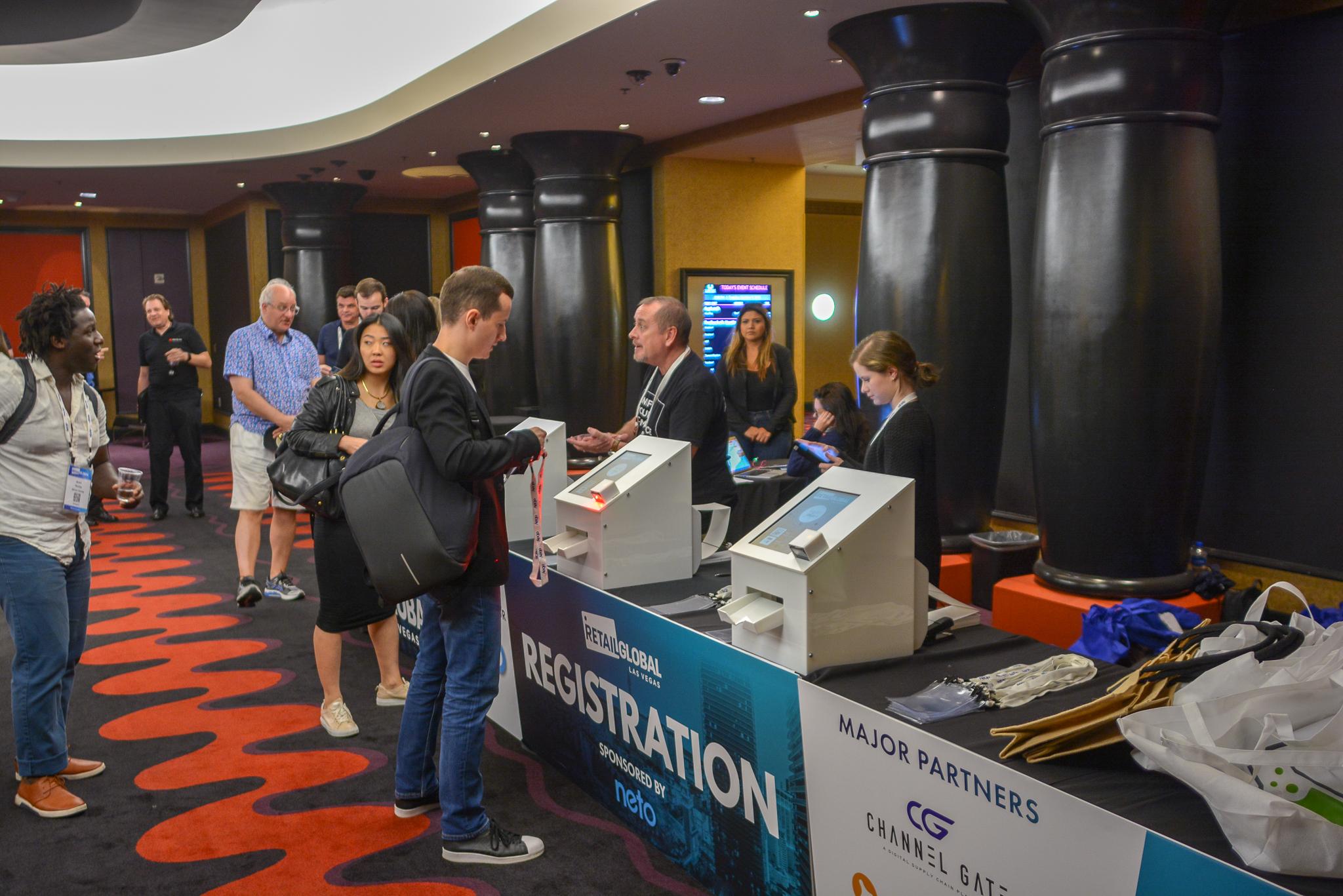 Delegates registering via exposcan kiosks