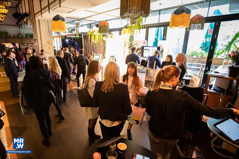 attendees browsing exhibitor spaces at Events Uncovered