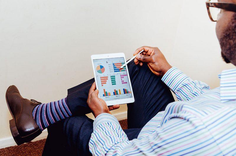 man looking at survey results on ipad