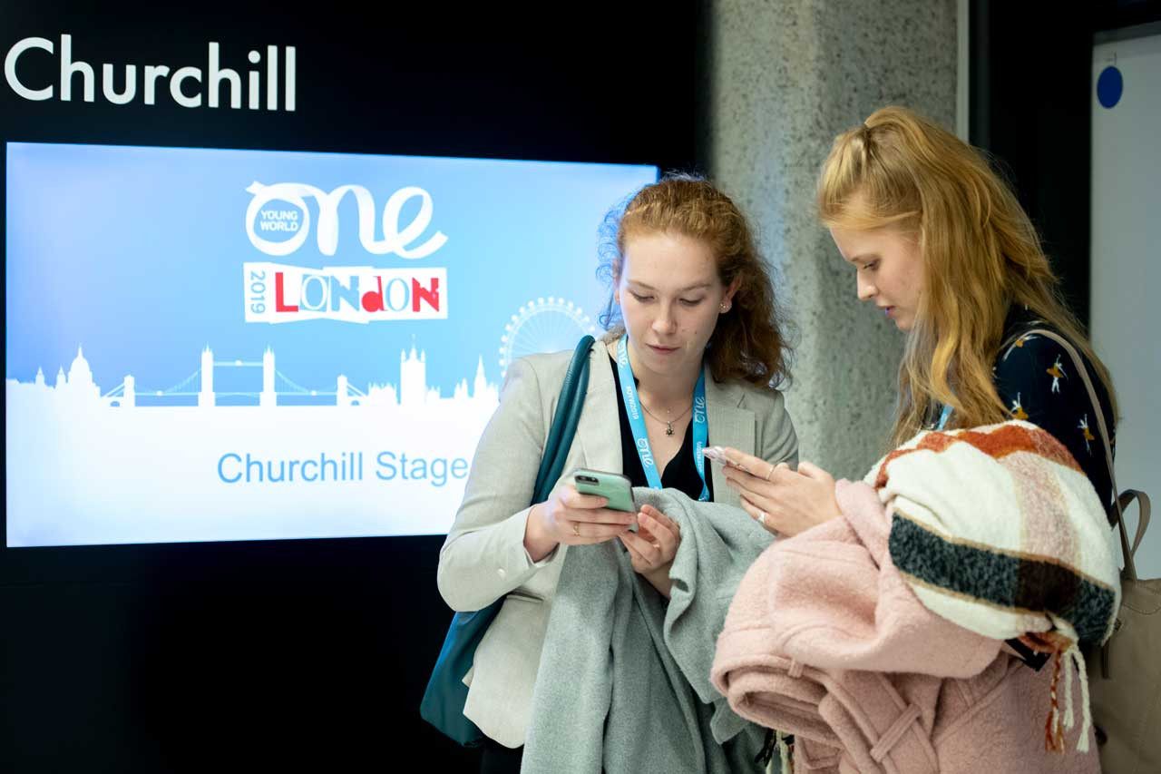delegates using the event app at the One Young World Summit