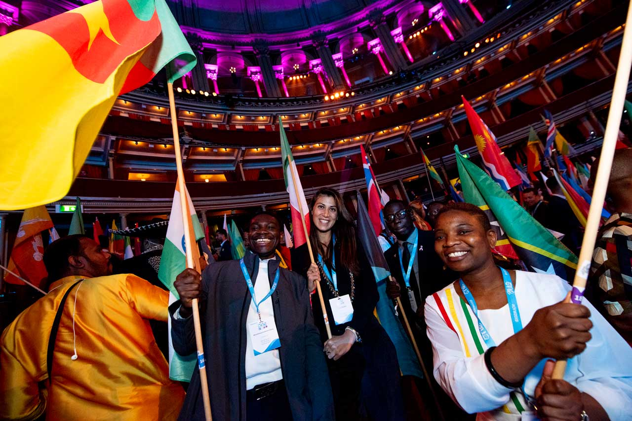 Delegates waving flags at One Young World Summit
